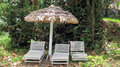Free Thatched Umbrella And Chairs Royalty Free Stock Photography - 64178957