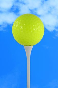 Yellow Golf Ball Against Blue Sky Royalty Free Stock Photo