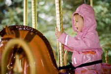 Free Girl On Carousel In The Rain Stock Photo - 6423670