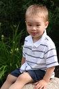 Free Boy Sitting On Rock Stock Image - 6430531