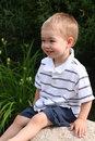 Free Boy Sitting On A Rock Royalty Free Stock Photos - 6430538