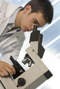 Free Young Scientist Watching Inside A Microscope Royalty Free Stock Photo - 6436075