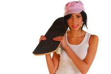 Free Young Latino Woman Holding A Skateboard Stock Photography - 6430902