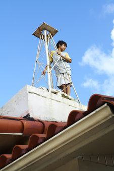 Free Boy On A Roof Royalty Free Stock Images - 6430909
