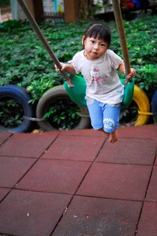 Free Chinese Child Was Playing Swing Stock Photos - 6431693