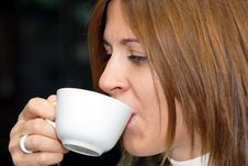 Attractive Female Enjoying A Cup Of Coffee Stock Images
