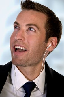 Free Portrait Of Businessman Listening Music Stock Photography - 6435602