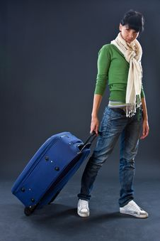 The Young Girl In A Scarf And Jeans With A Dark Bl Stock Photo