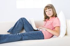 Girl With Laptop On Couch Royalty Free Stock Photos