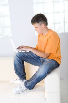 Free Young Boy Typing On Laptop Stock Images - 6436244