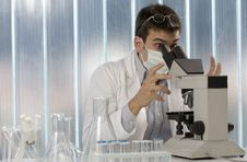 Young Scientist Working At The Microscope Royalty Free Stock Images
