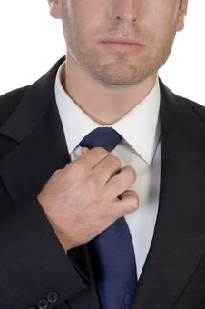Close Up Of Businessman Fixing His Tie Stock Photos