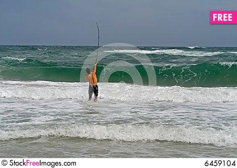 Free Man Surf Fishing Stock Images - 6459104