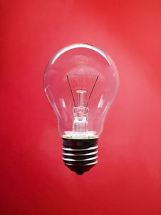 Lightbulb On Red Background Royalty Free Stock Images