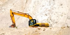 A Large Excavator Working In Sand Stock Photos