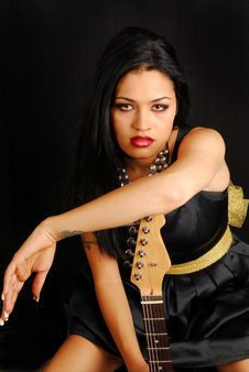 Free Latino Woman With Guitar Royalty Free Stock Images - 6452269