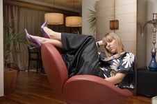 Free Beautiful Blonde Woman Sitting In An Armchair Stock Photography - 6455322