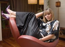 Free Beautiful Blonde Woman Sitting In An Armchair Stock Photos - 6455333