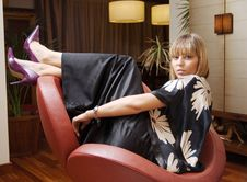 Free Beautiful Blonde Woman Sitting In An Armchair Stock Images - 6455474