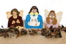 Free Three Figurine Christmas Choir Angels In Wood Stock Image - 6458001