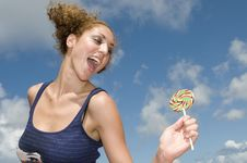 Free Fun Blonde Girl With Lollypop In Clouds Background Royalty Free Stock Images - 6458019