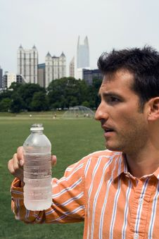 Man Taking A Break From Drinking Water Stock Photo