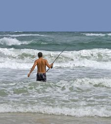 Man Surf Fishing Stock Image