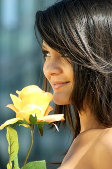 Young Woman With A Beautiful Yellow Rose Stock Image