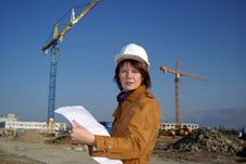 Free Woman Architect Holding Blueprints Against Cranes Stock Photography - 6465172
