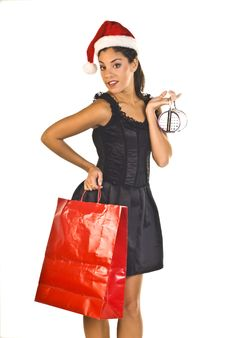 Free Lady Shopper With Santa Hat Royalty Free Stock Images - 6467329