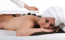 Pretty Smiling Lady Getting Hot Stone Massage Royalty Free Stock Images
