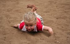 Little Girl In The Sand Royalty Free Stock Photos