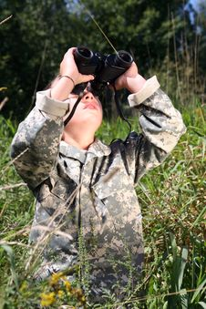 Free Boy In Camouflage Looking Up Through Binoculars Stock Image - 6471411