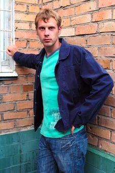 Young Stylish Man Stand Near Brick Wall. Royalty Free Stock Photos