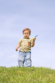 Boy With A Cellphone Stock Images