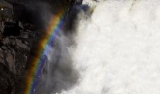 Free A Rainbow Over A Waterfall Royalty Free Stock Images - 6476219
