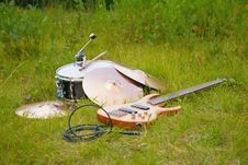 Free Musical Instruments, Guitar, Drum, Plates On Grass Stock Image - 6479881