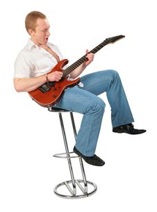 Free Young Man With Guitar On Chair Royalty Free Stock Photography - 6479987