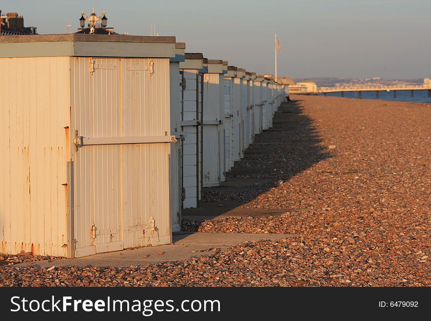 Sunset beach huts and pier