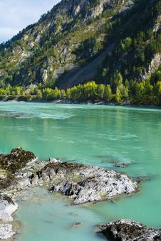 Rocks On The Turquoise River Bottom Royalty Free Stock Photo