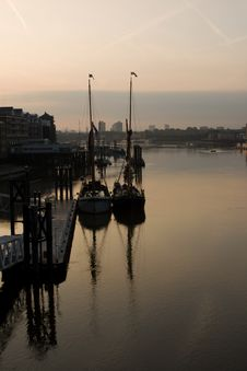 Sail Boats Reflecting Into The Thames Royalty Free Stock Images