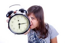 Free Young Woman With Alarm Clock Screaming Royalty Free Stock Photography - 6482627