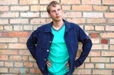 Young Stylish Man Stand Near Brick Wall. Royalty Free Stock Photography