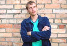 Young Stylish Man Stand Near Brick Wall. Royalty Free Stock Photo