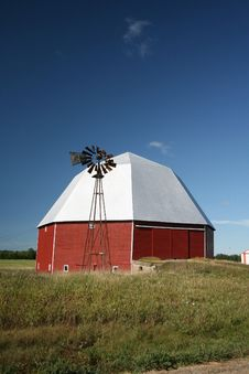Octagonal Barn And Windmill Royalty Free Stock Photography