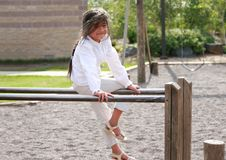 Free Little Girl Sitting Top Of Parallel Bars Stock Photos - 6484513
