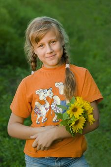 Girl With Sunflower Stock Image