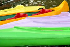 Free Coloured Canoes Ashore Of The Lake Stock Photos - 6488323