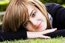 Free Smiling Beauty On Grass Royalty Free Stock Image - 6489986