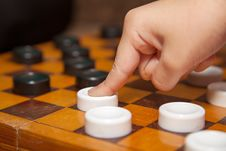 Finger Moves The Piece To The Chessboard Stock Photo
